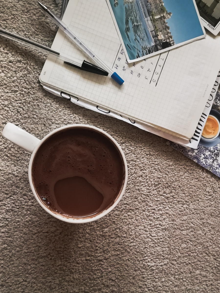 coffee cup and note book